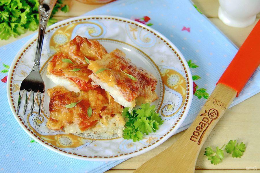 Минтай с сыром и томатами в духовке